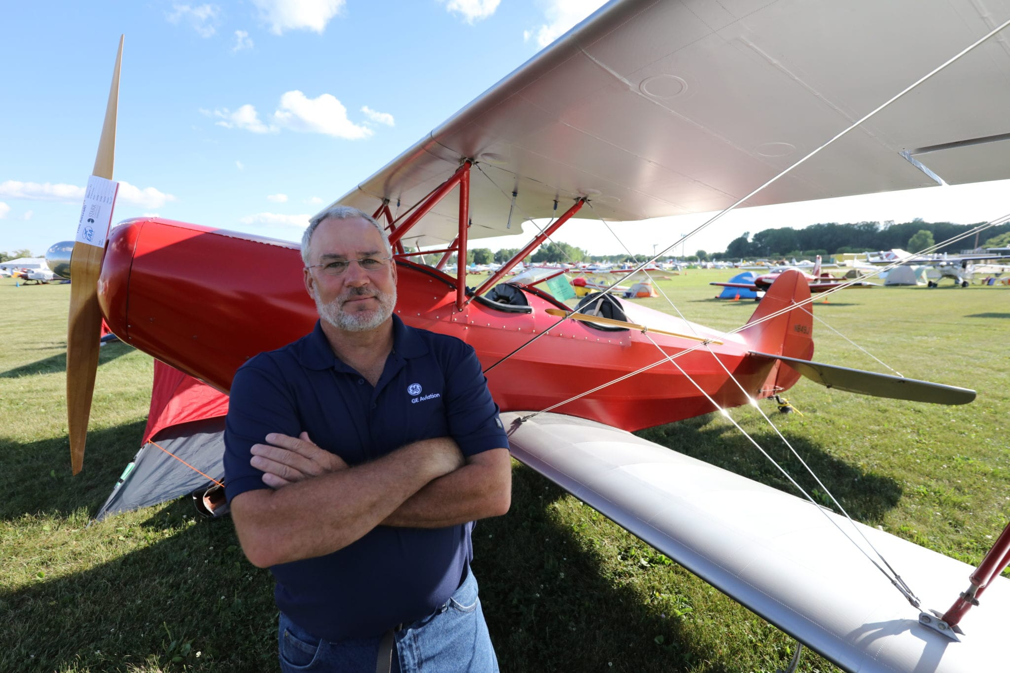 The sky was totally his: Jeff Beam flew his red biplane 800 miles to be at the Oshkosh fly-in